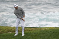 Patrick Cantlay hits the ball onto the seventh green of the Pebble Beach Golf Links during the final round of the AT&T Pebble Beach Pro-Am golf tournament Sunday, Feb. 14, 2021, in Pebble Beach, Calif. (AP Photo/Eric Risberg)