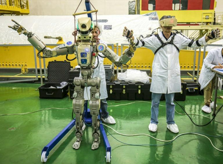 The robot can be operated manually by ISS astronauts wearing exoskeleton suits and it mirrors their movements (AFP Photo/-)