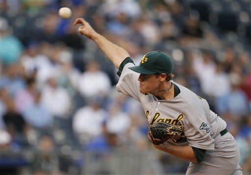 Oakland Athletics pitcher Dan Straily delivers in the second inning against the Kansas City Royals in Kansas City, Mo., Thursday, Aug. 16, 2012. (AP Photo/Colin E. Braley)