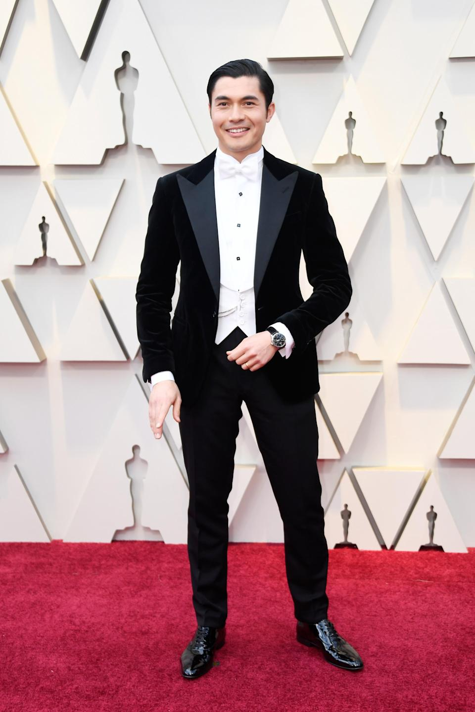 """<p>The """"Crazy Rich Asians"""" star brought back Old Hollywood glamour in a custom tuxedo by Ralph Lauren. (Image via Getty Images) </p>"""