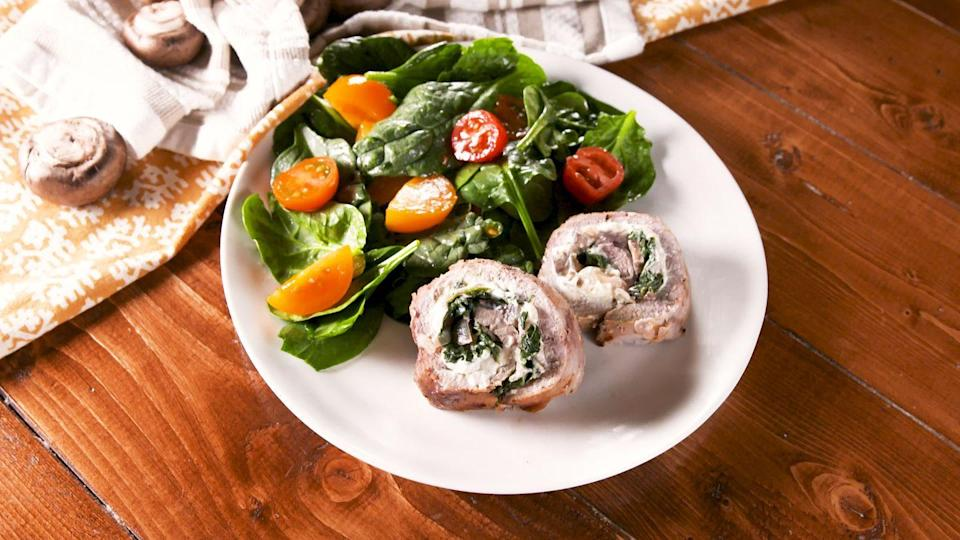 """<p>This easy stuffed pork tenderloin is the perfect solution for keto weeknight dinners.</p><p>Get the recipe from <a href=""""https://www.delish.com/cooking/recipe-ideas/a29489388/stuffed-pork-tenderloin-recipe/"""" rel=""""nofollow noopener"""" target=""""_blank"""" data-ylk=""""slk:Delish"""" class=""""link rapid-noclick-resp"""">Delish</a>. </p>"""
