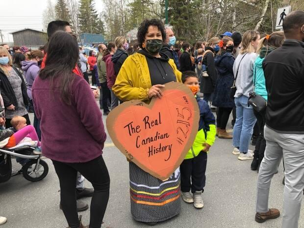 Jennifer Roberts was among the marchers in Yellowknife on Friday for the Dene Nation memorial march to honour the 215 children whose remains were discovered at a former residential school in Kamloops, British Columbia.