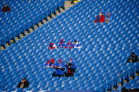 Buffalo Bills fans, sitting apart, watch as their team warm up before an NFL wild-card playoff football game against the Indianapolis Colts, Saturday, Jan. 9, 2021, in Orchard Park, N.Y. (AP Photo/Jeffrey T. Barnes)