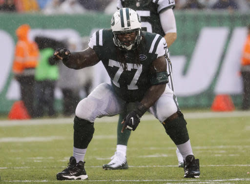 FILE - In this Oct. 29, 2017, file photo, New York Jets offensive guard James Carpenter gets set at the line of scrimmage during an NFL football game against the Atlanta Falcons at MetLife Stadium in E. Rutherford, N.J. After Matt Ryan agreed to restructure his contract to clear cap space, the Atlanta Falcons spent that money on two new starting guards, Jamon Brown and James Carpenter, to help protect the quarterback. (Winslow Townson/AP Images for Panini via AP, File)