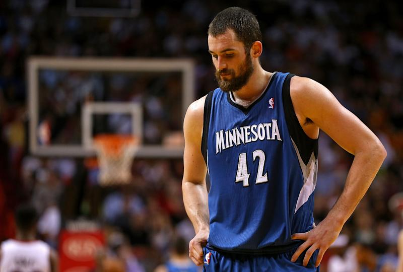 Kevin Love of the Minnesota Timberwolves looks on during a game against the Miami Heat at American Airlines Arena on December 18, 2012 in Miami, Florida