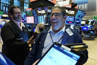 Trader Robert Oswald, right, works on the floor of the New York Stock Exchange, Wednesday, Sept. 22, 2021. Stocks rose broadly on Wall Street Wednesday ahead of an update from the Federal Reserve on how and when it might begin easing its extraordinary support measures for the economy. (AP Photo/Richard Drew)