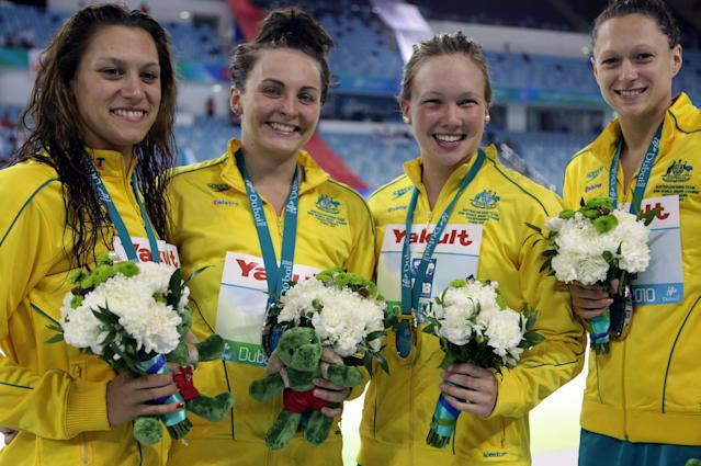 Australian swimmers (L-R) Kylie Palmer, Kelly Stubbins, Jade Nielsen and Blair Evans pose for a picture with their silver medals after finishing second in the women's 4x200m freestyle relay at the FINA World Short Course Championships in Dubai on December 15, 2010. AFP PHOTO/PATRICK BAZ (Photo credit should read PATRICK BAZ/AFP/Getty Images)