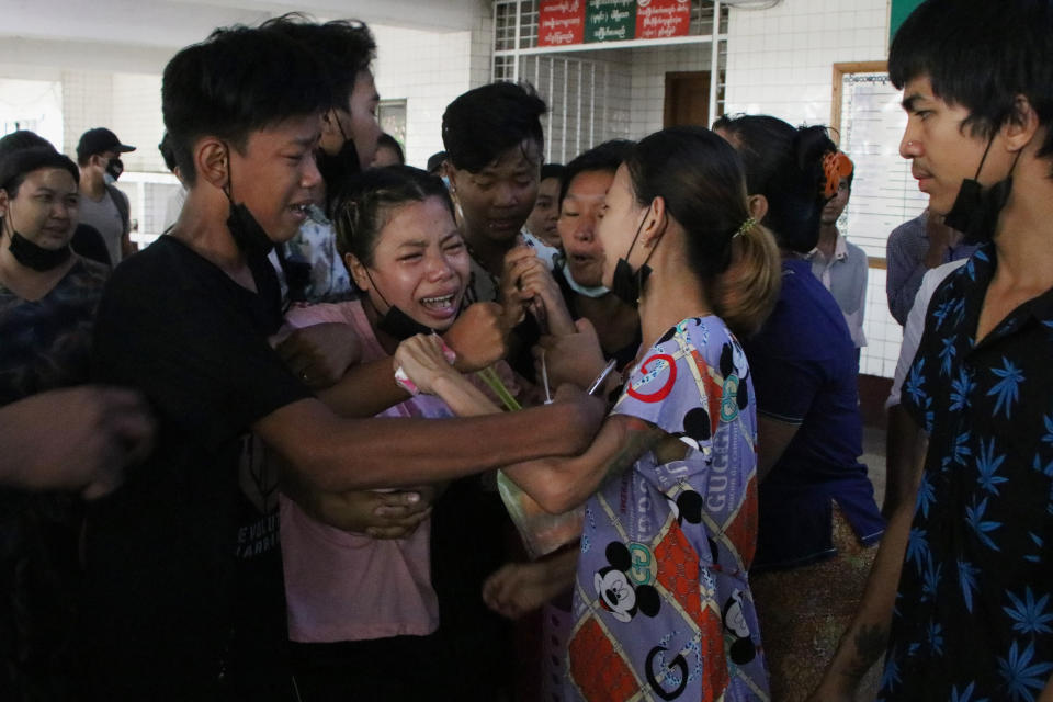 "People mourn over the death of a man who was killed during a clash with Myanmar's security forces, during his cremation in Yangon, Myanmar, Monday, March 29, 2021. Over 100 people across the country were killed by security forces on Saturday alone, including several children — a toll that has prompted a U.N. human rights expert to accuse the junta of committing ""mass murder"" and to criticize the international community for not doing enough to stop it. (AP Photo)"