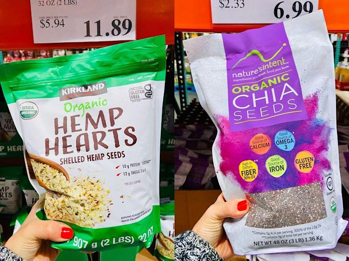 On the left, a hand holding a green and white pack of hemp hearts. On the right, a hand holding a purple and white bag of chia seeds