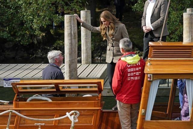 Kate gets on a boat