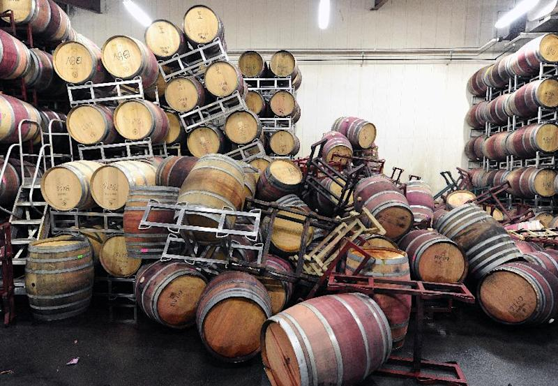 Barrels are strewn about inside the storage room of Bouchaine Vineyards in Napa, California after an earthquake struck the area, August 24, 2014