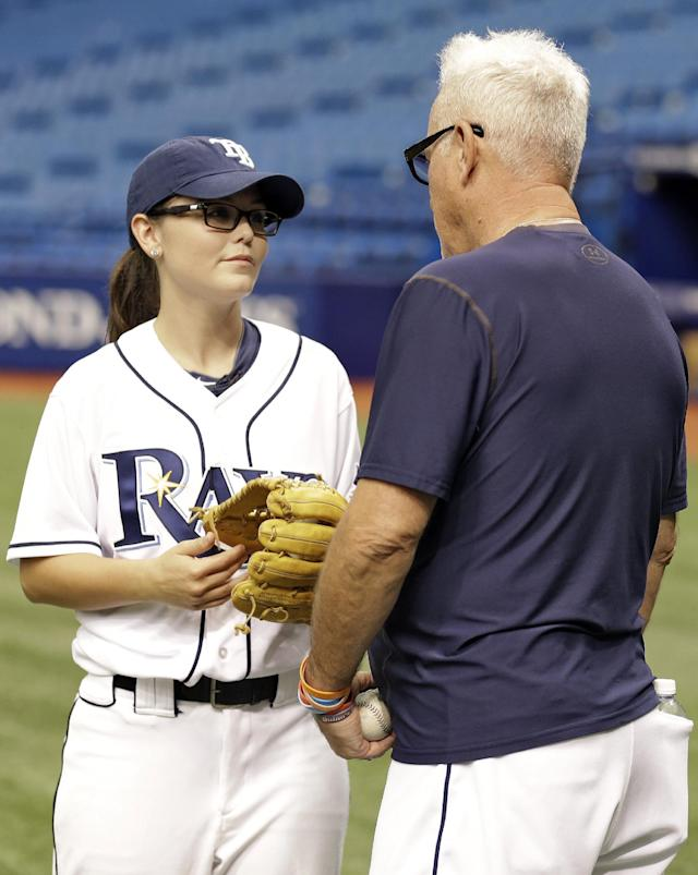 Chelsea Baker, a junior knuckleball pitcher on the Durant, Fla., High School boys baseball team, talks to Tampa Bay Rays manager Joe Maddon before throwing batting practice to members of the Rays before an interleague baseball game against the Pittsburgh Pirates Monday, June 23, 2014, in St. Petersburg, Fla. (AP Photo/Chris O'Meara)