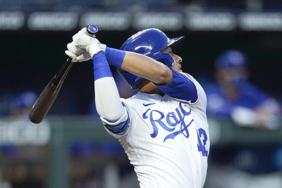 Kansas City Royals' Nicky Lopez watches his RBI-triple during the third inning of a baseball game against the Toronto Blue Jays, Thursday, April 15, 2021, in Kansas City, Mo. (AP Photo/Charlie Riedel)
