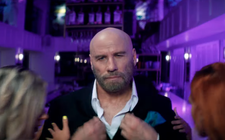 Travolta in the new Pitbull video (Credit: RCA)