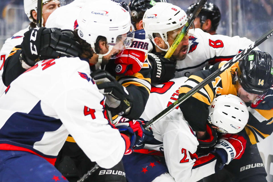 BOSTON, MA - MAY 19: Chris Wagner #14 of the Boston Bruins and Justin Schultz #2 of the Washington Capitals fight for the puck in Game Three of the First Round of the 2021 Stanley Cup Playoffs at TD Garden on May 19, 2021 in Boston, Massachusetts. (Photo by Adam Glanzman/Getty Images)
