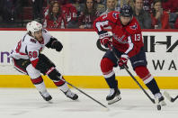 Washington Capitals left wing Jakub Vrana (13) and Ottawa Senators left wing Mike Hoffman (68) chase the puck during the second period of an NHL hockey game Tuesday, Feb. 27, 2018, in Washington. (AP Photo/Pablo Martinez Monsivais)