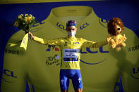 France's Julian Alaphilippe, wearing the overall leader's yellow jersey celebrates on podium after winning the second stage of the Tour de France cycling race over 186 kilometers (115,6 miles) with start and finish in Nice, southern France, Sunday, Aug. 30, 2020. (Stuart Franklin/Pool photo via AP)