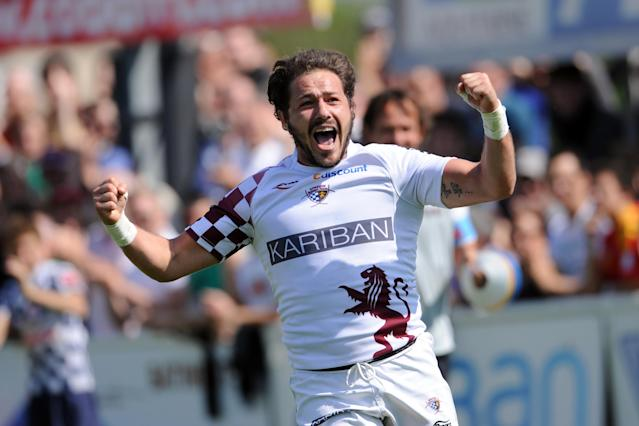 Begles-Bordeaux' Laurent Ferreres celebrates after scoring a try during the French Top 14 rugby union match Begles-Bordeaux vs. Perpignan on May 12, 2012, at the Andre Moga stadium in the French southeastern city of Begles. AFP PHOTO / NICOLAS TUCATNICOLAS TUCAT/AFP/GettyImages