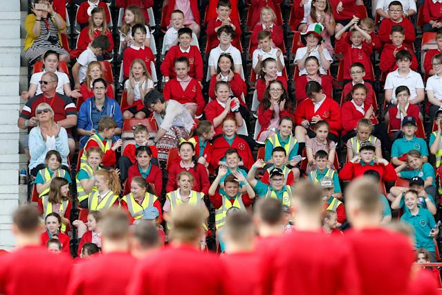 Soccer Football - Wales Training - The Racecourse, Wrexham, Britain - May 21, 2018 School children look on during Wales training Action Images via Reuters/Craig Brough