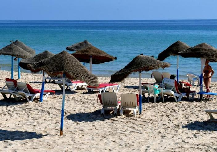 Tourists are seen along a hotel beach in Tunisia's coastal city of Sousse