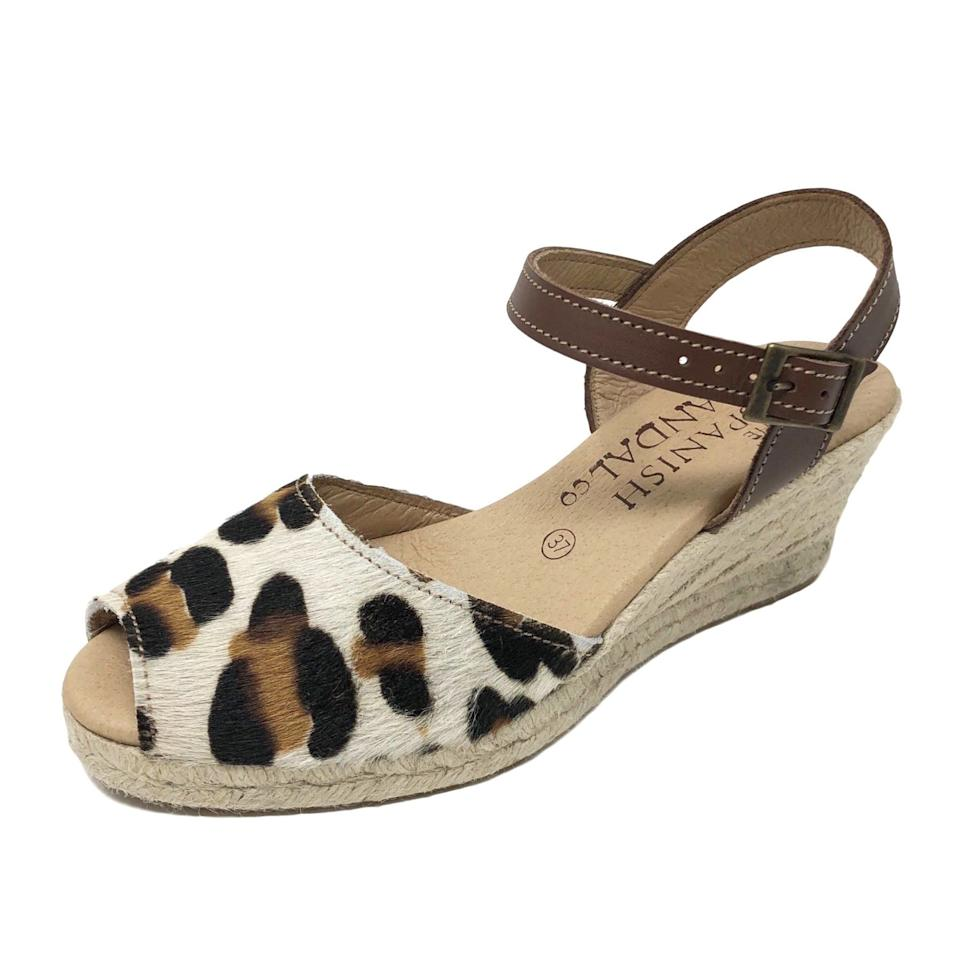 """<h3><a href=""""https://thespanishsandalco.com/"""" rel=""""nofollow noopener"""" target=""""_blank"""" data-ylk=""""slk:The Spanish Sandal Co."""" class=""""link rapid-noclick-resp"""">The Spanish Sandal Co.</a></h3><p><strong>Dates:</strong> Now - September 3<br><strong>Sale:</strong> 30% - 50% off sitewide<br><strong>Promo Code:</strong> None</p><p>The traditional Spanish sandal style known as the """"avarca"""" gets a modern boost with a leopard print design. The bonus? It's marked down 30% until after Labor Day.</p><br><br><strong>The Spanish Sandal Co.</strong> Leopard print espadrille wedges with strap, $62.3, available at <a href=""""https://thespanishsandalco.com/collections/women/products/leopard-print-espadrille-wedges-with-strap"""" rel=""""nofollow noopener"""" target=""""_blank"""" data-ylk=""""slk:The Spanish Sandal Co."""" class=""""link rapid-noclick-resp"""">The Spanish Sandal Co.</a>"""