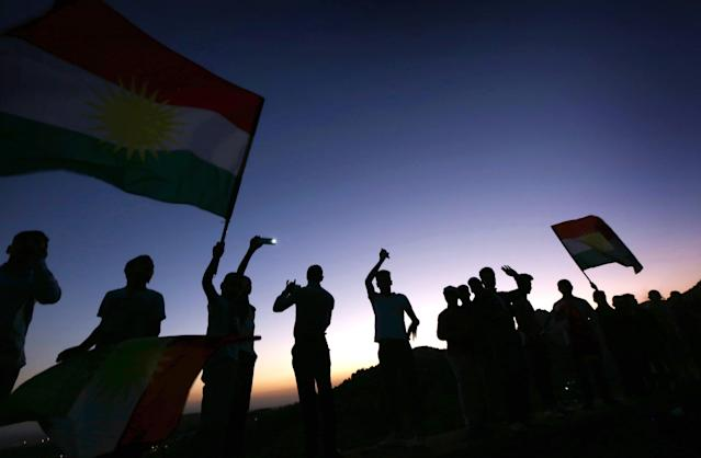 <p>Iraqi Kurds wave Kurdish flags during a gathering on Sept. 10, 2017, to show support for the upcoming independence referendum and encourage people to vote in the town of Akra, roughly 300 miles north of Baghdad. (Photo: Safin Hamed/AFP/Getty Images) </p>