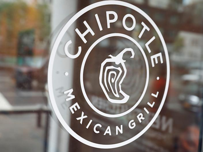 FILE PHOTO: The logo of Chipotle Mexican Grill is seen at the Chipotle Next Kitchen in Manhattan, New York, U.S., June 28, 2018.  REUTERS/Shannon Stapleton