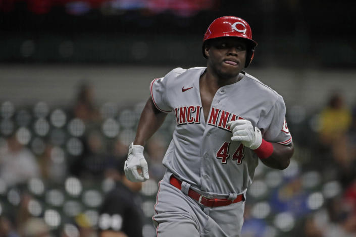 Cincinnati Reds' Aristides Aquino runs the bases after hitting a two-run home run during the ninth inning of a baseball game against the Milwaukee Brewers, Monday, June 14, 2021, in Milwaukee. (AP Photo/Aaron Gash)