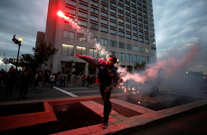 <p>A protester throws a flare at a protest march during the G7 Summit in Quebec City, Quebec, Canada, June 7, 2018. (Photo: Chris Wattie/Reuters) </p>