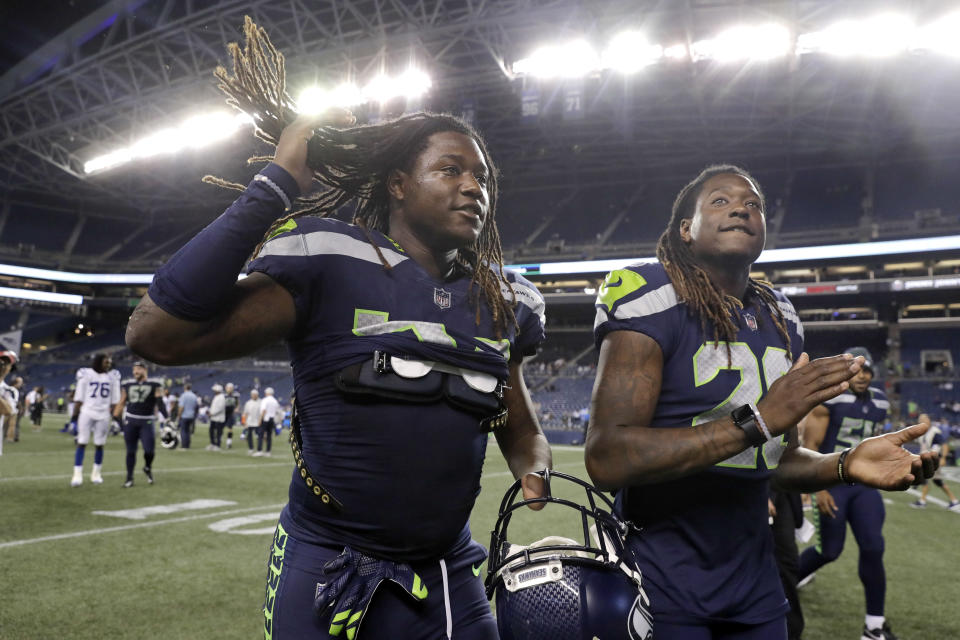 Shaquem Griffin, left, will make his NFL debut next Sunday along his brother cornerback Shaquill Griffin. (AP)