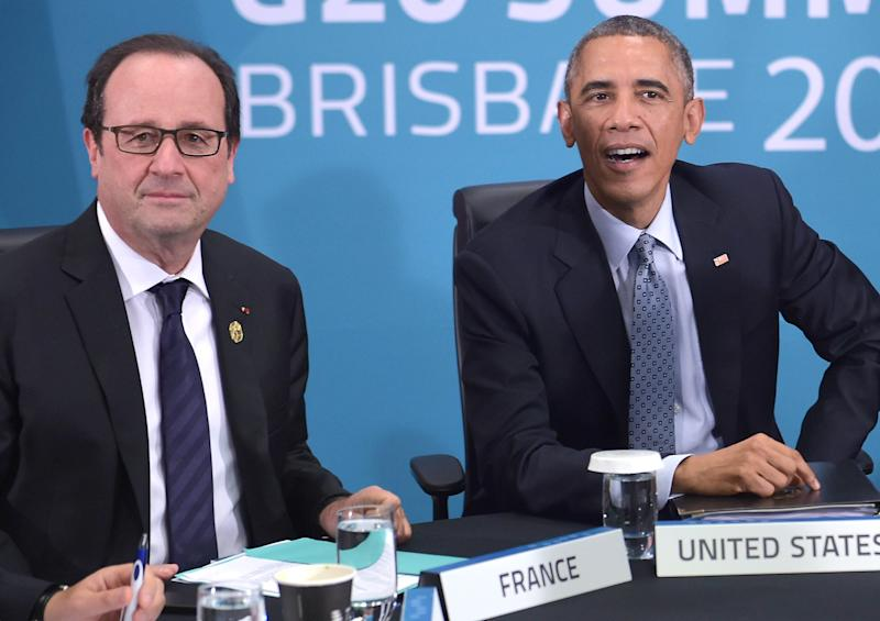 France's President Francois Hollande (L) and US President Barack Obama take part in a multilateral meeting on the sidelines of the G20 Summit in Brisbane on November 16, 2014 (AFP Photo/Mandel Ngan)