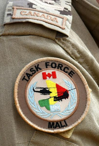 The uniform patch on the shoulder of a Canadian soldier with the United Nations Multidimensional Integrated Stabilization Mission in Mali (MINUSMA)
