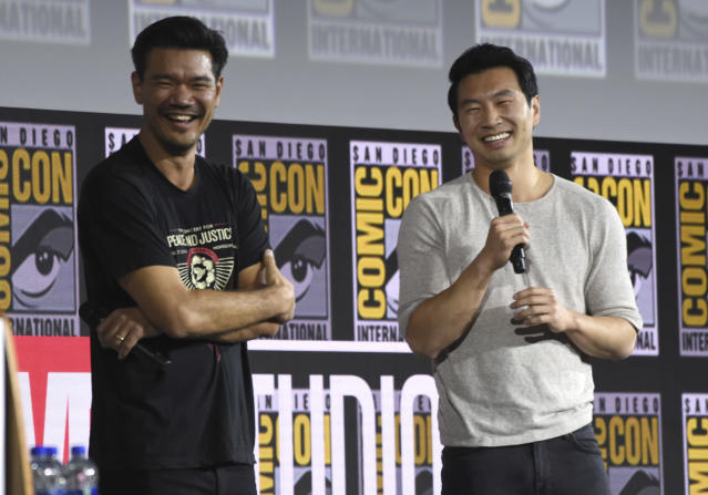 """Destin Daniel Cretton, left, and Simu Liu speaks during the """"Shang-Chi and The Legend of the Ten Rings"""" at Comic-Con International, 2019. (Chris Pizzello/Invision/AP)"""