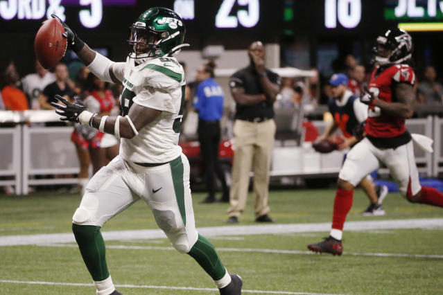 New York Jets outside linebacker James Burgess (58) runs the ball into the end zone for a touchdown against the Atlanta Falcons during the second half an NFL preseason football game, Thursday, Aug. 15, 2019, in Atlanta. (AP Photo/Andrea Smith)