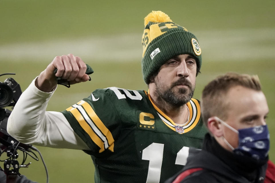 Green Bay Packers quarterback Aaron Rodgers pumps his first after an NFL divisional playoff football game against the Los Angeles Rams Saturday, Jan. 16, 2021, in Green Bay, Wis. The Packers defeated the Rams 32-18 to advance to the NFC championship game. (AP Photo/Morry Gash)