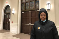 Corliss Bonner poses for a photo in front of the Friendship Baptist Church in downtown Atlanta, Tuesday, Jan. 5, 2021. Bonner, a 57-year-old chef, got up at the crack of dawn Tuesday and stood in line at an Atlanta church to cast a ballot for her pastor, the Rev. Raphael Warnock. Bonner's been a longtime member of the church he leads, Ebenezer Baptist Church. (AP Photo/Haleluya Hadero)
