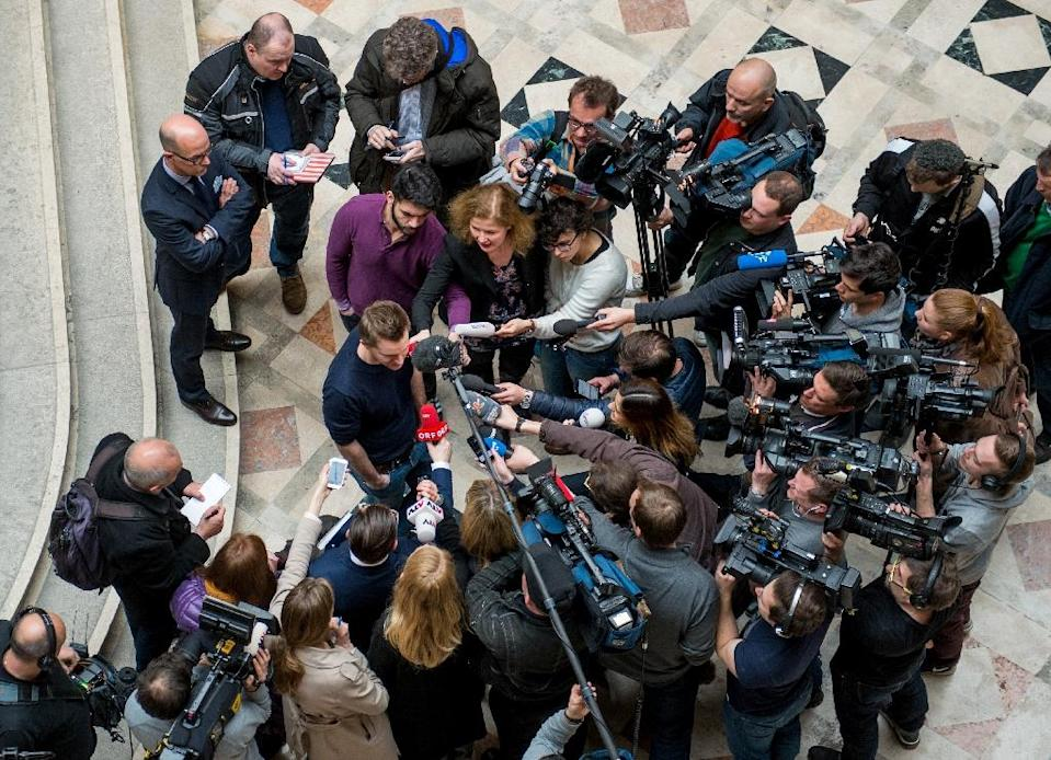 Austrian activist Max Schrems talks to journalists in the courthouse after officially filing a suit against Facebook in Vienna on April 9, 2015 (AFP Photo/Christian Bruna)