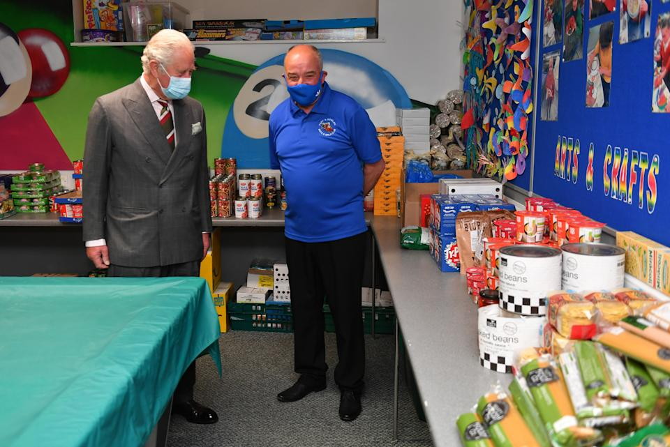 The Prince of Wales meets volunteers and staff during a visit to the Engine House food bank in Merthyr Tydfil, South Wales. Picture date: Friday May 14, 2021.