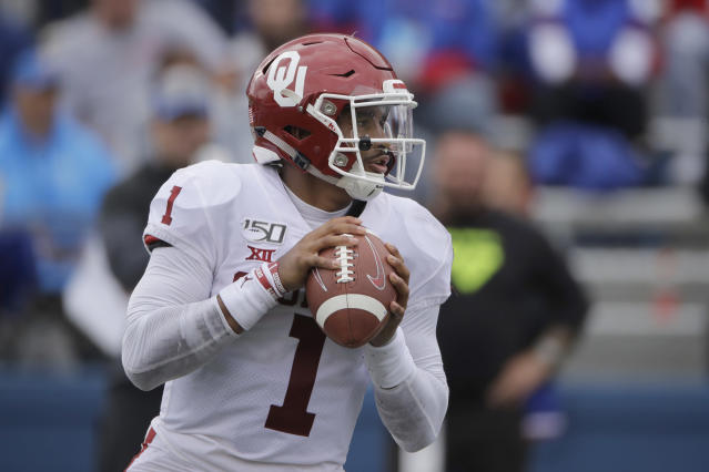 Oklahoma quarterback Jalen Hurts looks for a receiver during the second half of an NCAA college football game against Kansas, Saturday, Oct. 5, 2019, in Lawrence, Kan. (AP Photo/Charlie Riedel)