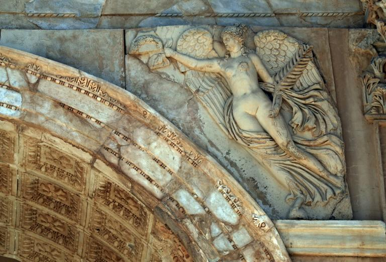 Carved detail of the Septimius Severus arch, which is named for the Roman emperor born in Leptis Magna and who lavished resources on his hometown (AFP/Mahmud TURKIA)