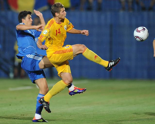 Ionut Gugu (R) of Romania vies for the ball with Anastasios Bakasetas (L) of Greece during the final football match of the UEFA European Under-19 Championship 2010/2011 in Berceni village next to Bucharest July 23, 2011. Greece won 1-0. AFP PHOTO/DANIEL MIHAILESCU (Photo credit should read DANIEL MIHAILESCU/AFP/Getty Images)