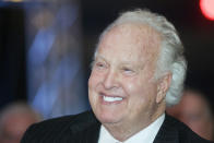 """File-This Jan. 25, 2011, file photo shows 1956 Heisman Trophy winner and Louisville native Paul Hornung smiling at comments by former coach Howard Schnellenberger during the Paul Hornung Award ceremony in Louisville, Ky. Hornung, the dazzling """"Golden Boy"""" of the Green Bay Packers whose singular ability to generate points as a runner, receiver, quarterback, and kicker helped turn them into an NFL dynasty, has died, Friday, Nov. 13, 2020. He was 84. (AP Photo/Brian Bohannon)"""