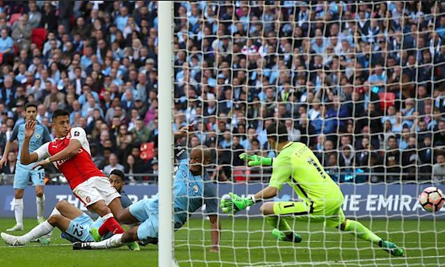 """<span class=""""element-image__caption"""">Alexis Sánchez scores his side's second goal of the game during extra-time in the FA Cup semi-final at Wembley.</span> <span class=""""element-image__credit"""">Photograph: Nick Potts/PA</span>"""