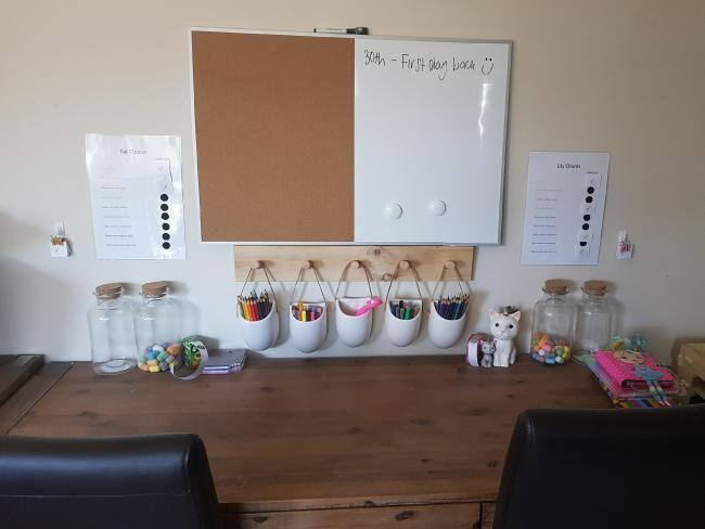 Not only did Belinda save her kids time having to run around in the morning looking for their items but she also created an after-school homework area with study desks and hanging pencil cases. Photo: Belinda Hampson