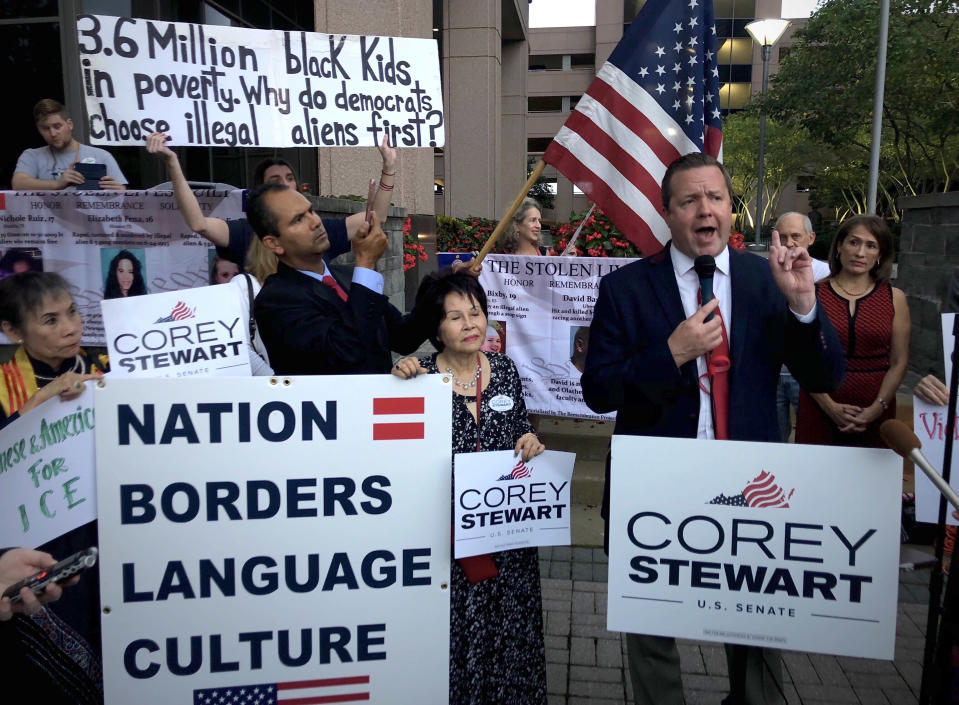 Stewart, right, speaks before a group of about 35 supporters in front of an Immigration and Customs Enforcement office in Fairfax, Va. (Photo: Michael S. Williamson/The Washington Post)