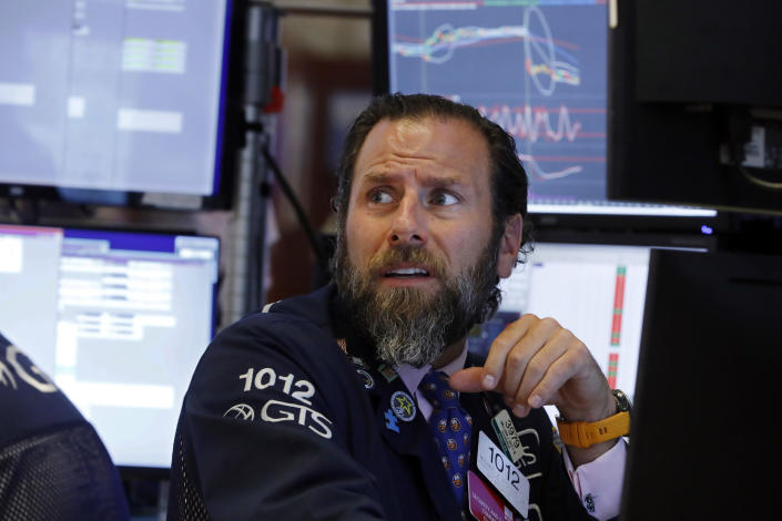 Specialist Micael Pistillo works at his post on the floor of the New York Stock Exchange, Wednesday, Aug. 14, 2019. Stocks are falling sharply after the bond market threw up another warning flag on the economy. (AP Photo/Richard Drew)