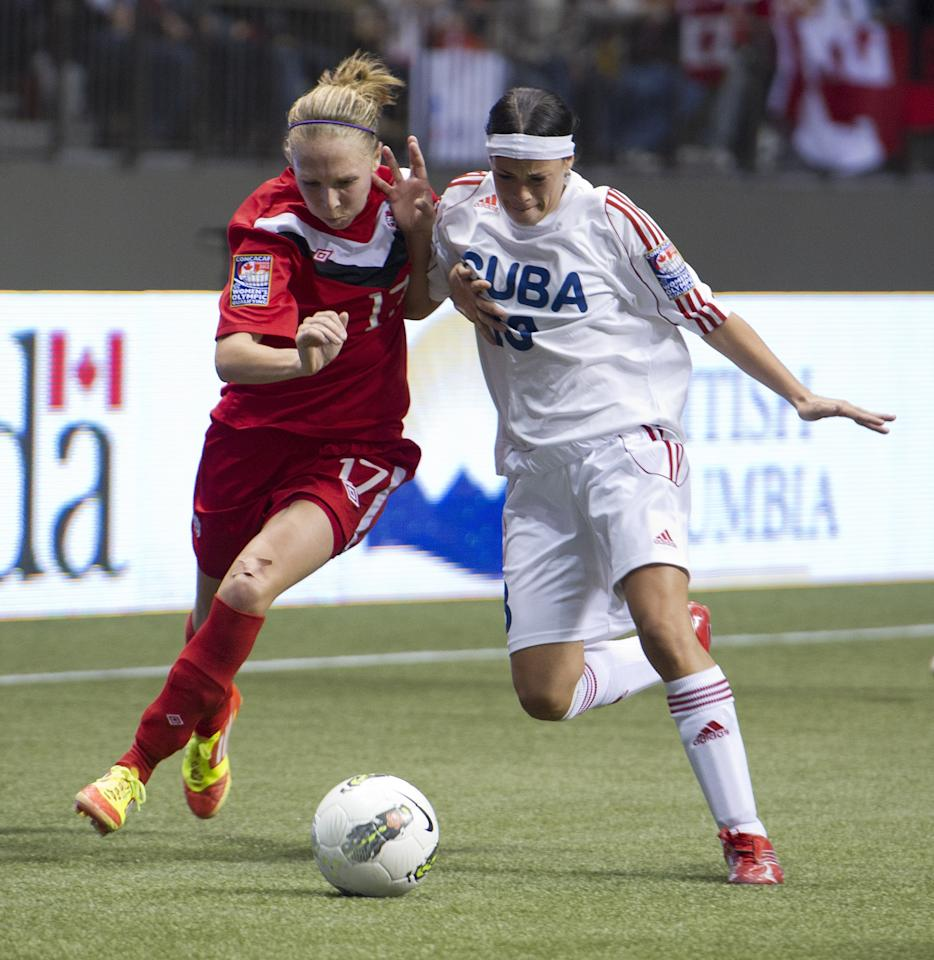 VANCOUVER, CANADA - JANUARY 21:  Brittany Timko #17 of Canada battles with Maria Perez #13 of Cuba for the loose ball during the second half of the 2012 CONCACAF Women's Olympic Qualifying Tournament at BC Place on January 21, 2012 in Vancouver, British Columbia, Canada.  (Photo by Rich Lam/Getty Images)