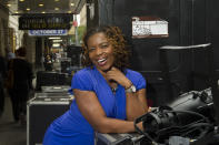 """FILE - Playwright Katori Hall poses for a portrait in front of the Bernard B. Jacobs Theatre in New York on Sept, 21, 2011. Hall won the Pulitzer Prize for drama for her play """"The Hot Wing King."""" (AP Photo/Charles Sykes, File)"""