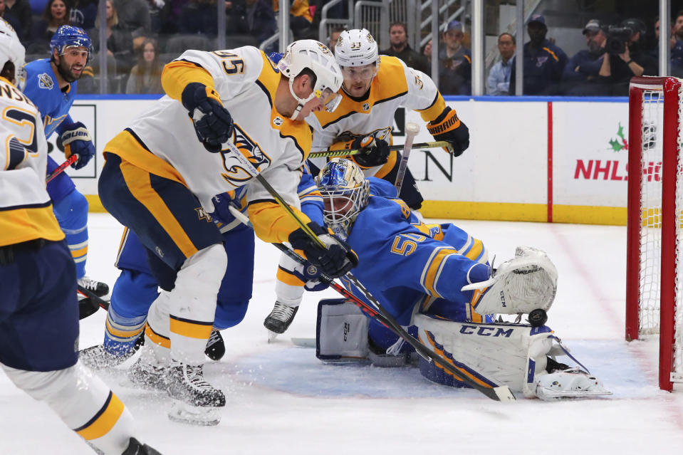 St. Louis Blues goalie Jordan Binnington (50) makes a save against Nashville Predators' Matt Duchene (95) during the first period of an NHL hockey game Saturday, Nov. 23, 2019, in St. Louis. (AP Photo/Dilip Vishwanat)