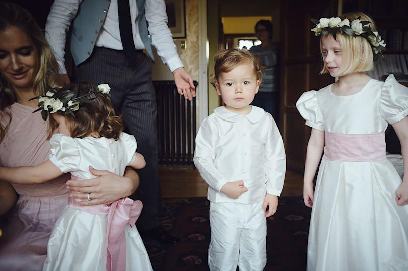 Flower girls and page boys caught unawares. I love this shot—it's like a Singer Sargent painting!